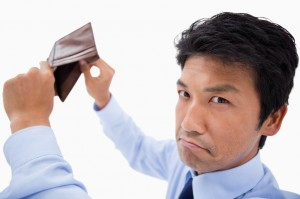 Broke businessman showing his empty wallet
